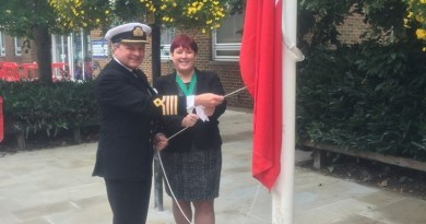 Deputy Mayor, Karen Hamilton raising UK Merchant Navy Flag