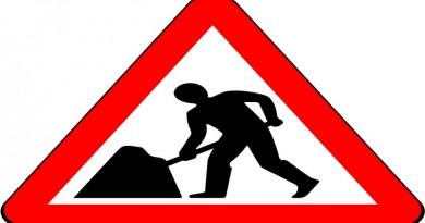 Men at Work Sign