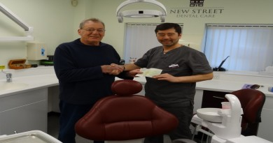 Cllr Cockaday presents grant to Dr Chen.JPG