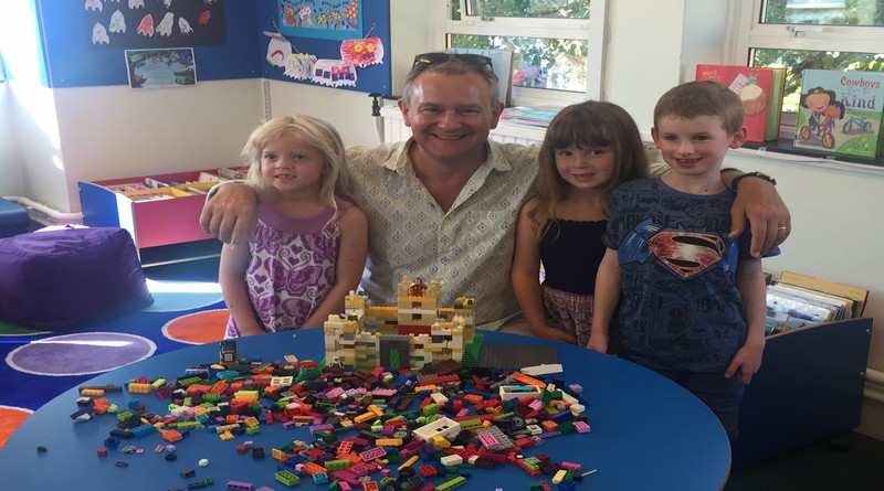 Hugh Bonneville donating his family lego to New Milton library and meeting local children Clarissa, Rosie and Dylan