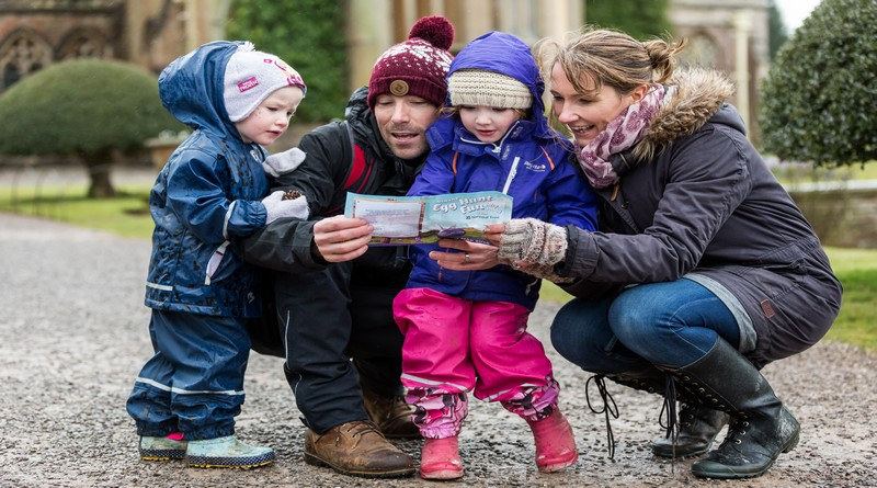 Family with Cadbury Easter trail sheet ©National Trust Images