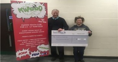 Councillor-Dowden-presents-Sarah-with-the-cheque