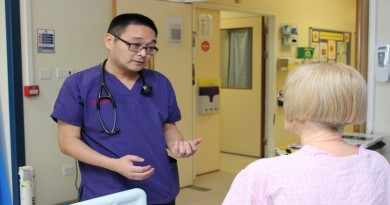 Dr Matt Inada-Kim, the National Clinical Sepsis Advisor, checks on a patient at Royal Hampshire County Hospital