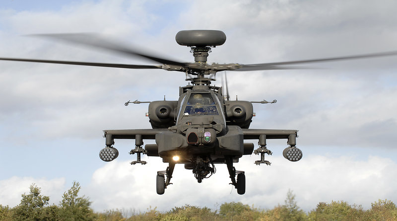 An Army Air Corps Apache attack helicopter takes off during an exercise on the Barton Stacey Training Area (BSTA) near Winchester.   Designed to hunt and destroy tanks, the Apache attack helicopter has significantly improved the Army's operational capability.  Apache can operate in all weathers, day or night and detect, classify and prioritise up to 256 potential targets in a matter of seconds. It carries a mix of weapons including rockets, Hellfire missiles and a 30mm chain gun.  In addition to the distinctive Longbow Radar located above the rotor blades, this aircraft is equipped with a Day TV system, Thermal Imaging sight and Direct View Optics. Defensively it possesses a state of the art fully integrated Defensive Aid Suite.