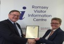 Councillor David Drew receiving the certificate for Romsey's Coach Friendly Town Status