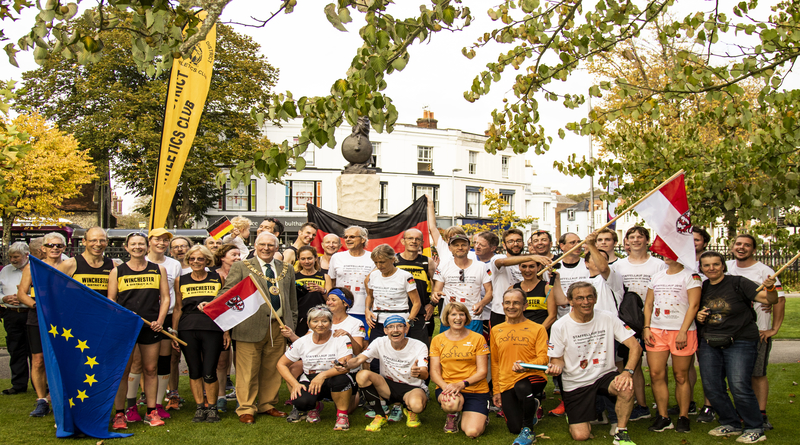 Twin runners arrive in Winchester from Giessen, Germany