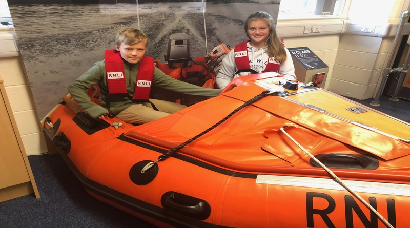 Eleanor and her brother in an RNLI lifeboat