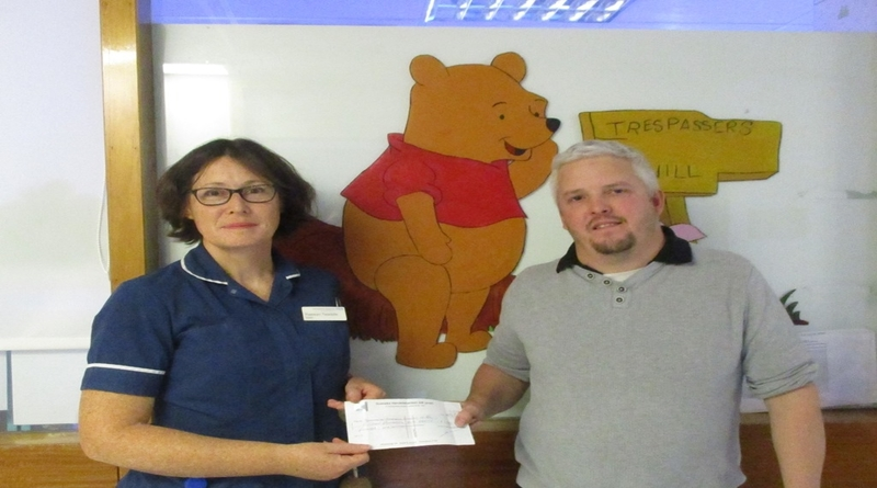 Raewyn Twaddle and Adam Kill cheque presentation for RHCH