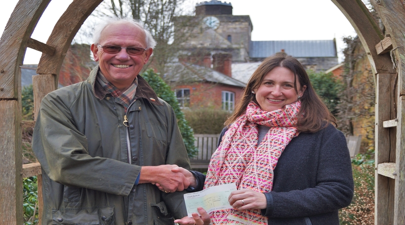 Cllr Clive Collier presents the £750 Business Incentive Grant to Business Owner Jessica Nicholson.