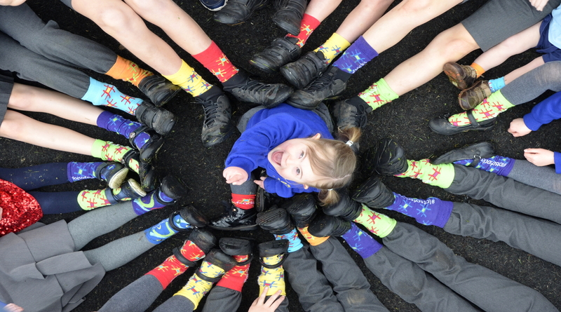 Rosie Barnett and pupils wearing odd socks as St John the Baptist School support World Down Syndrome Day!