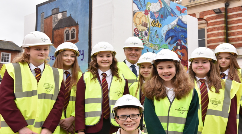 School children add a dash of colour to Lord Palmerston as Romsey Market Place improvements continue