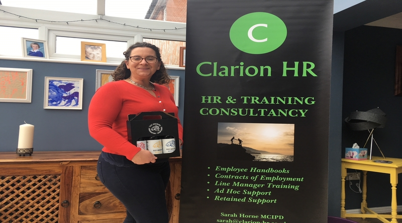 Sarah Horne of Clarion HR receives her entry prize