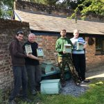 Bird boxes and bug hotels with people supported by Minstead Trust