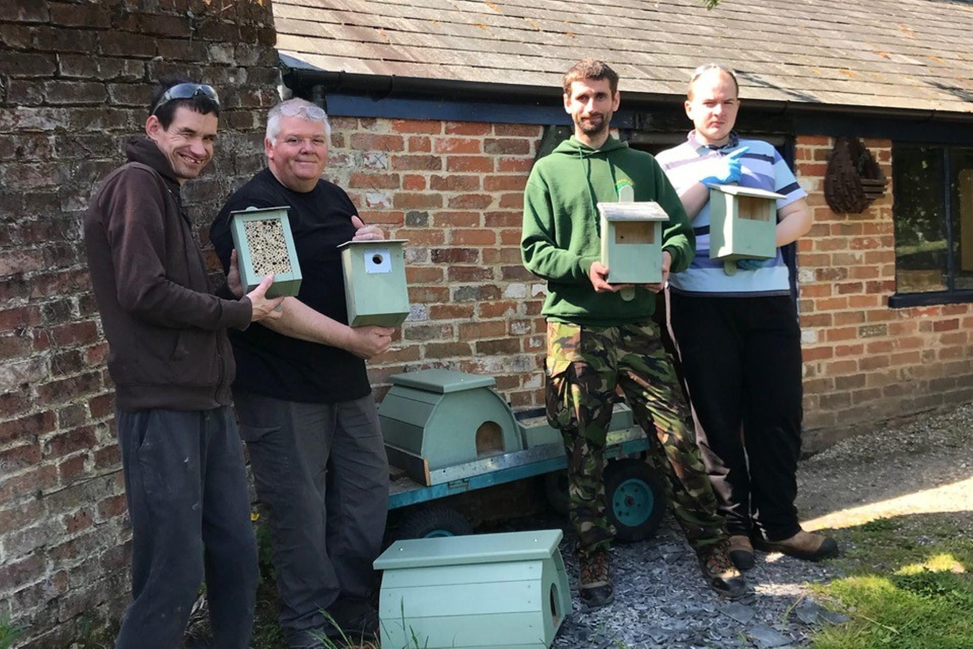 Bird boxes&bug hotels with people supported by Minstead Trust