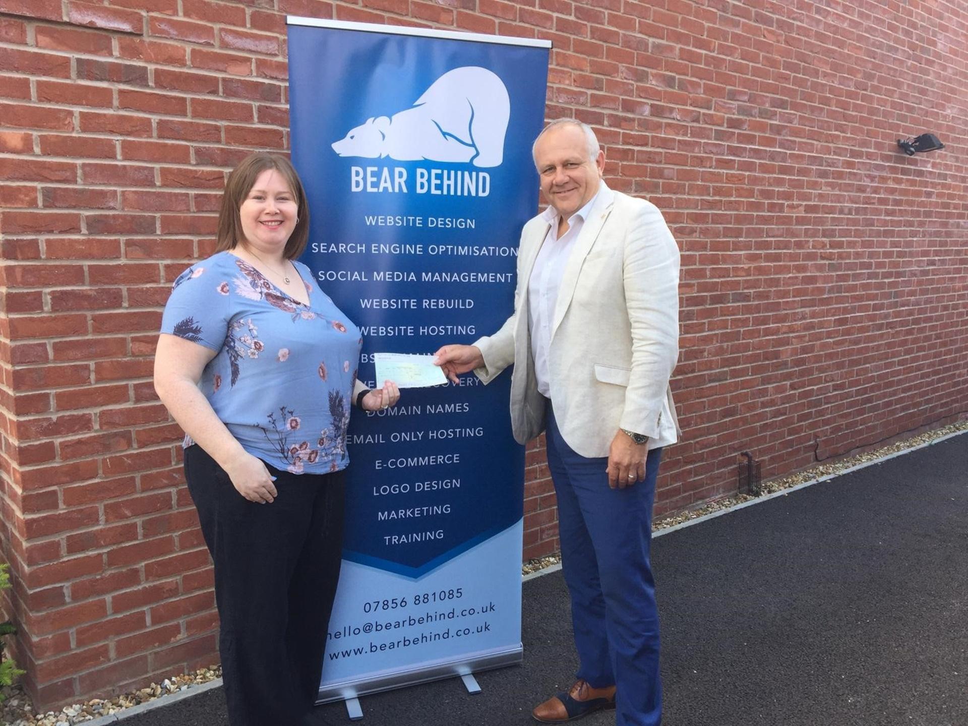 Councillor Matthews presents cheque to Katie Brook