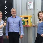 Elliotts Living Spaces employees with the 24-hour access defibrillator