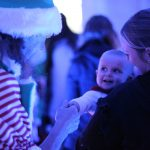 Christmas At Marwell - baby meeting an elf.