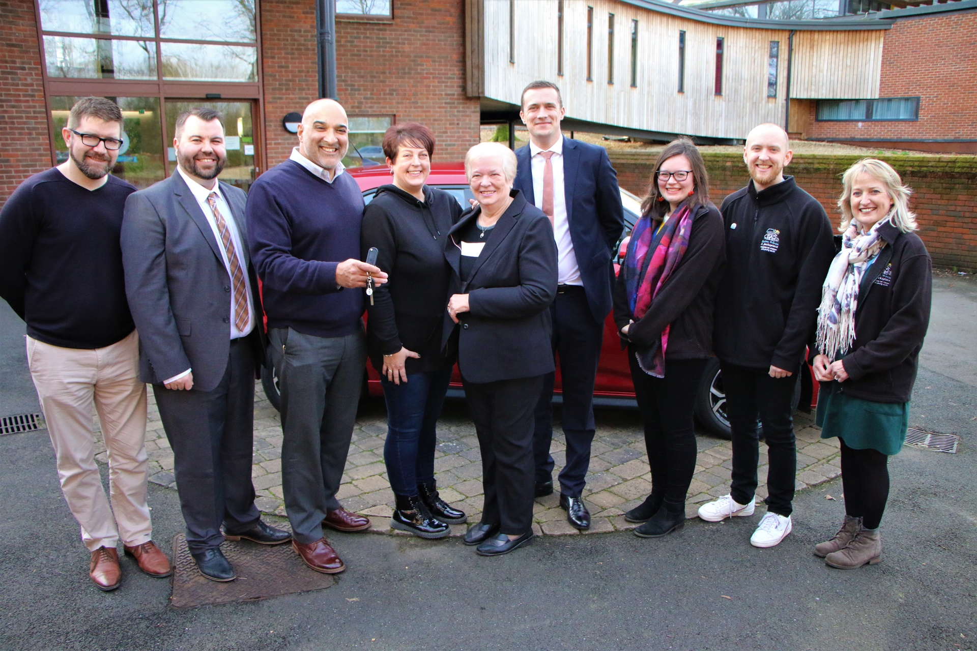 Winner of charity lottery drives away in brand new car