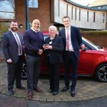 Winner of charity lottery drives away in brand new car 4