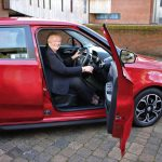 Winner of charity lottery drives away in brand new car 1