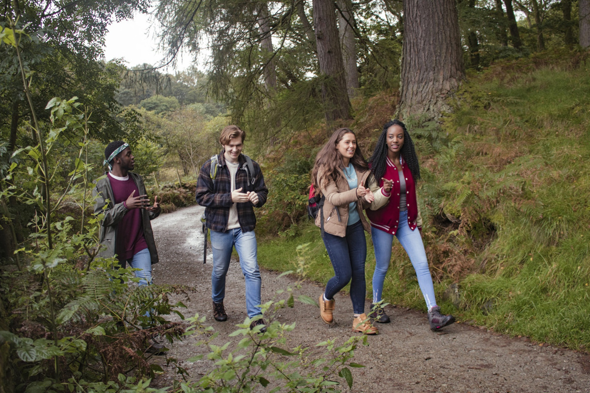 Young people walking in woodland
