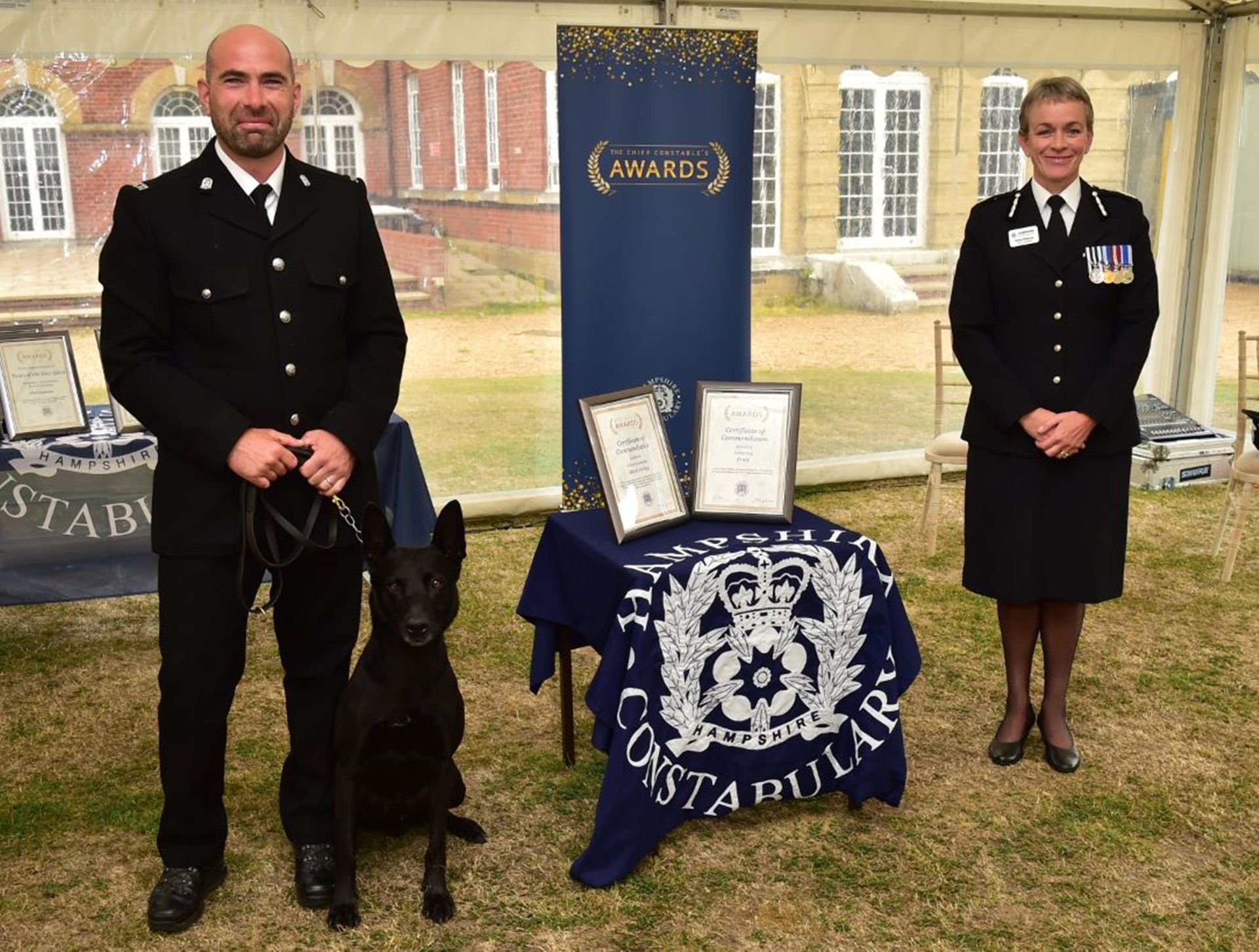 Mark with dog Ernie and Chief Constable